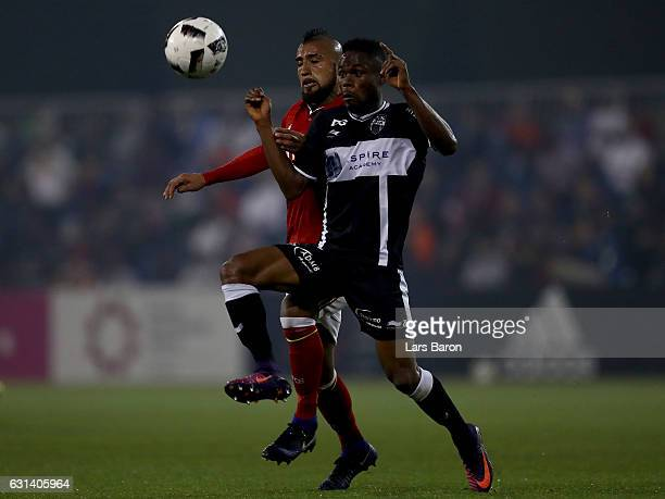 Arturo Vidal of Muenchen challenges Odeni George of Eupen during the friendly match between Bayern Muenchen and KAS Eupen on January 10 2017 in Doha...