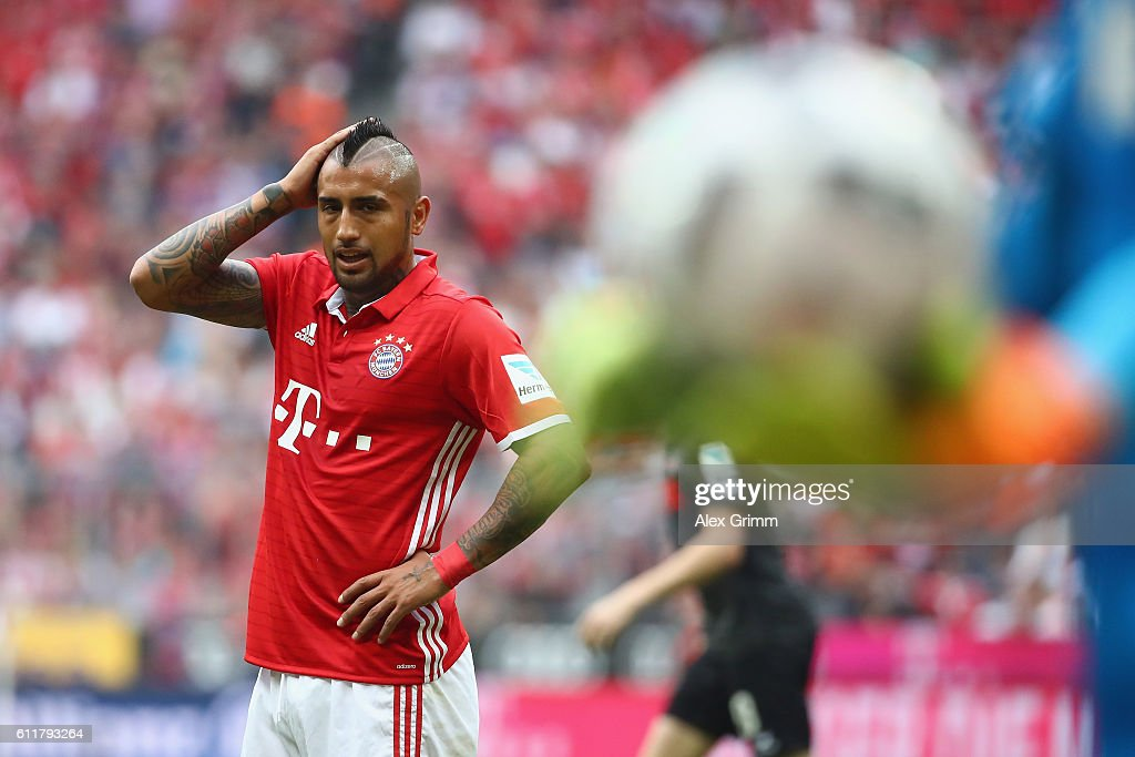Arturo Vidal of Muenchen reacts after missing a chance to score during the Bundesliga match between Bayern Muenchen and 1. FC Koeln at Allianz Arena on October 1, 2016 in Munich, Germany.