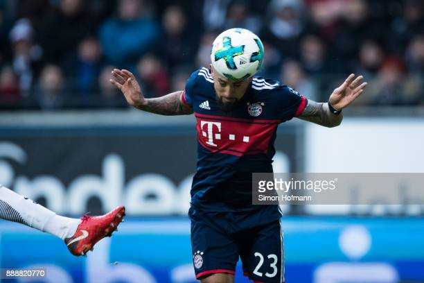 Arturo Vidal of Muenchen scores his team's first goal with a header past goalkeeper Lukas Hradecky of Frankfurt during the Bundesliga match between...