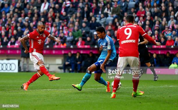 Arturo Vidal of Muenchen scores the opening goal during the Bundesliga match between Bayern Muenchen and Hamburger SV at Allianz Arena on February 25...