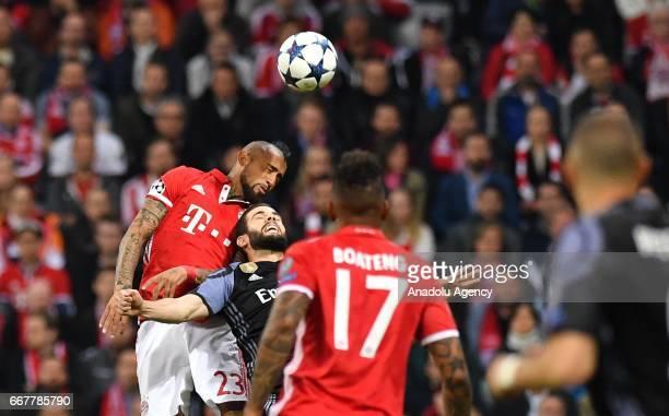 Arturo Vidal of Munich and Nacho Fernandez of Madrid vie for the ball during the UEFA Champions League 1st leg quarter final football match between...