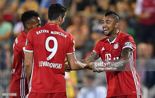 Arturo Vidal of Munich celebrates after scoring to make it 40 with teammates Robert Lewandowski and Julian Green during the DFB Cup match between FC...