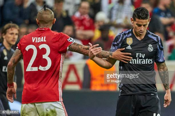 Arturo Vidal of Munich shakes hands with James Rodriguez of Real Madrid during the UEFA Champions League Quarter Final first leg match between FC...