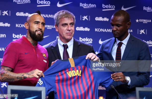 Arturo Vidal poses with Jordi Mestre and Eric Abidal during the press conference presentation of Arturo Vidal as new player of FC Barcelona on 06th...