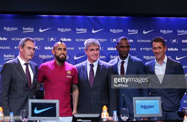 Arturo Vidal poses with Pep Segura Jordi Mestre and Eric Abidal during the press conference presentation of Arturo Vidal as new player of FC...