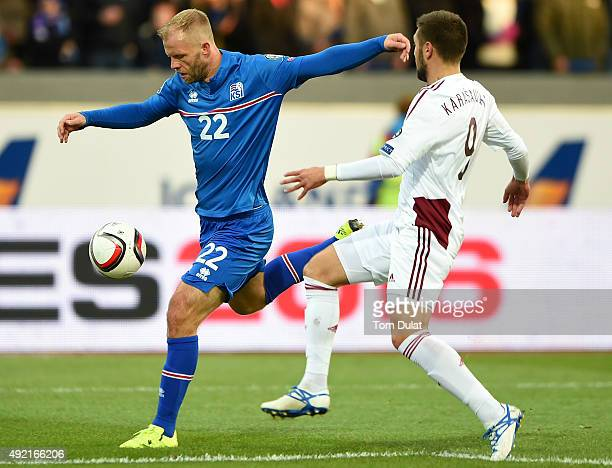 Arturs Karasausks of Latvia and Eidur Gudjohnsen of Iceland in action during the UEFA EURO 2016 Qualifier match between Iceland and Latvia at...