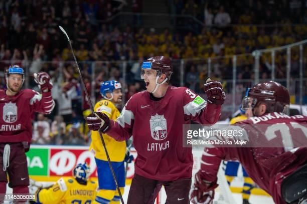 Arturs Kulda of Latvia celebrates a goal of Roberts Bukarts of Latvia during the 2019 IIHF Ice Hockey World Championship Slovakia group game between...
