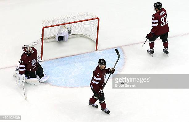 Arturs Kulda, Sandis Ozolins of Latvia and Kristers Gudlevskis of Latvia react during the Men's Ice Hockey Quarterfinal Playoff against Canada on Day...