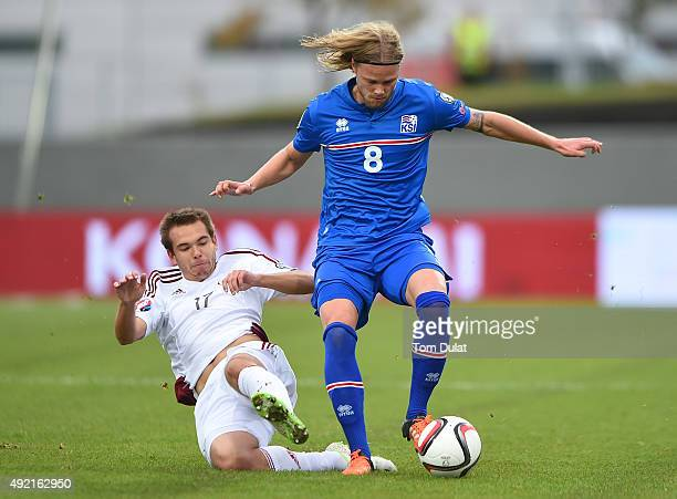 Arturs Zjuzins of Latvia and Birkir Bjarnason of Iceland in action during the UEFA EURO 2016 Qualifier match between Iceland and Latvia at...