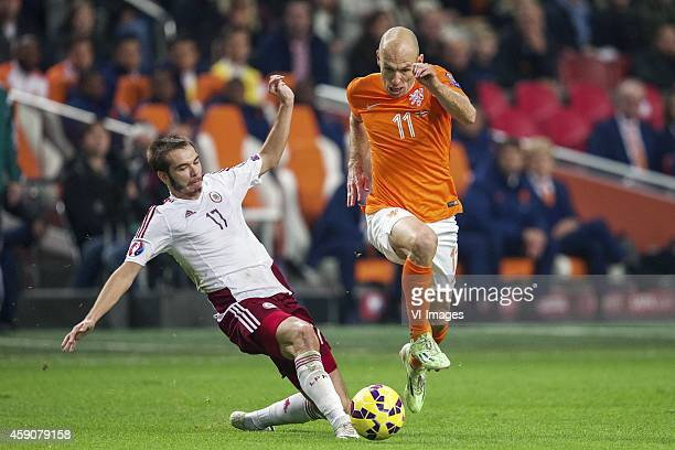 Arturs Zjuzins of Latvia Arjen Robben of Holland during the match between Netherlands and Latvia on November 16 2014 at the Amsterdam Arena in...