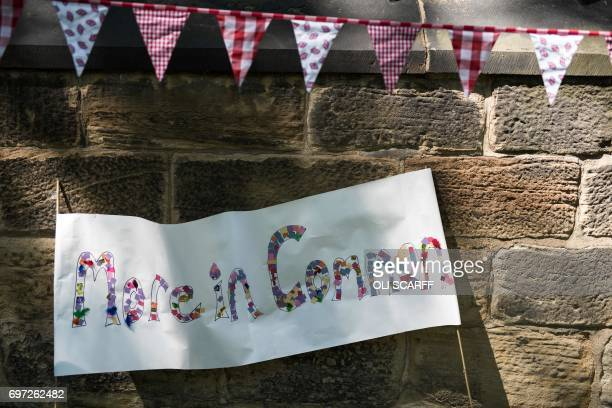 Artwork bearing a quote from murdered Member of Parliament Jo Cox is displayed at a 'Great Get Together' community service and picnic in memory of...