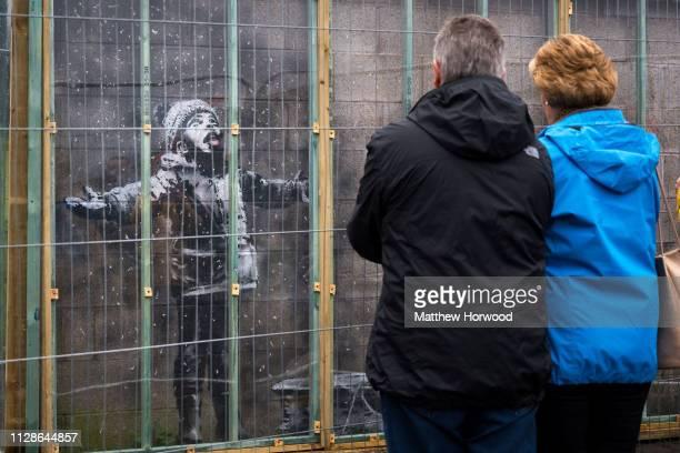 Artwork by artist Banksy in Port Talbot near the Tata Steel steelworks on January 20, 2019 in Port Talbot, United Kingdom. The British graffiti...