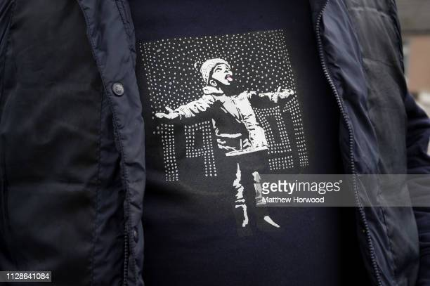 Artwork by artist Banksy printed on a jumper worn by a visitor to the artwork on January 20 2019 in Port Talbot United Kingdom The British graffiti...
