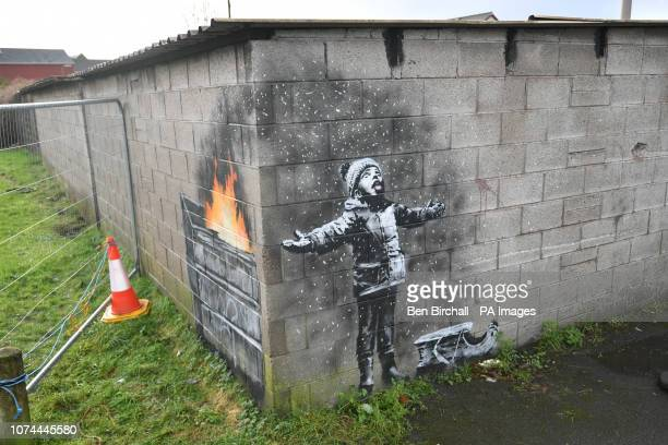 Artwork by street artist Banksy which has appeared on a garage wall in Taibach Port Talbot south Wales The painting appeared overnight and shows a...
