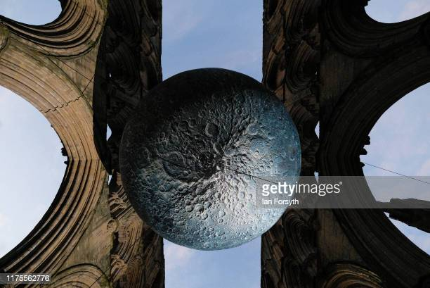 Artwork called The Museum of the Moon by Luke Jerram helps to illuminate English Heritage's Rievaulx Abbey on September 18 2019 in Helmsley North...