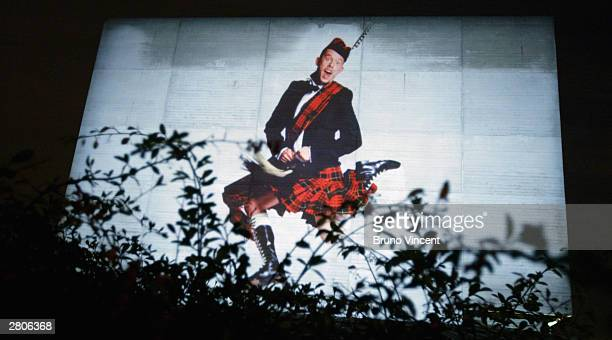 Artwork chosen by David Bailey including a giant image of designer Alexander McQueen in his kilt lights up the National Theatre as part of a number...