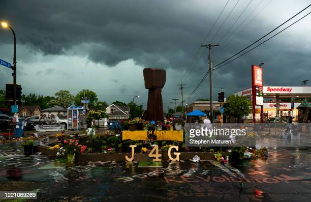"""Artwork is posted outside the Cup Foods at 38th St and Chicago Avenue on June 18, 2020 in Minneapolis, Minnesota. The intersection, dubbed """"George..."""