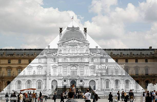 Artwork of French street artist and photographer JR is displayed on the Louvre Pyramid on May 25 2016 in Paris France French street artist JR has...