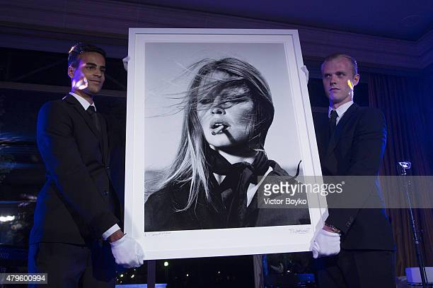 Artworks being auctioned during the amfAR dinner at the Pavillon LeDoyen during the Paris Fashion Week Haute Couture on July 5 2015 in Paris France