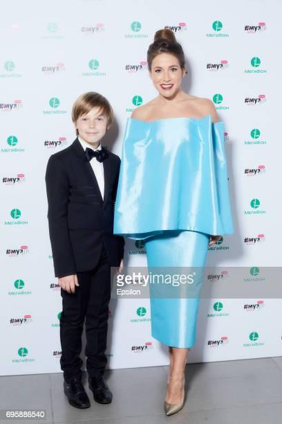 Artyom Arshavin and Yulia Baranovskaya attend the 2017 MuzTV Music Awards ceremony at Olimpiyskiy Stadium on June 9 2017 in Moscow Russia