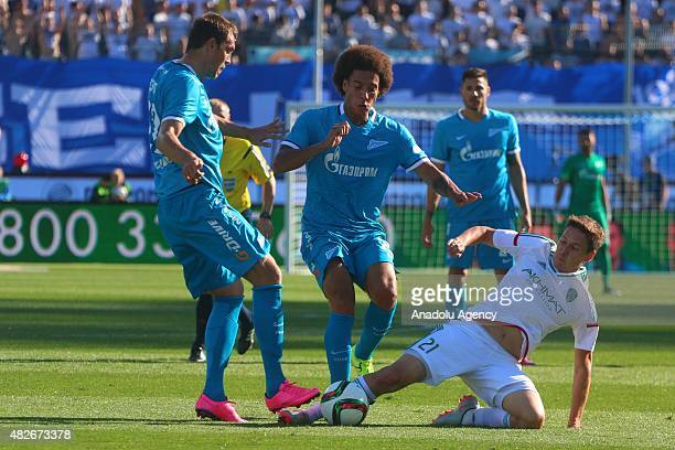 Artyom Dzuba and Axe Witsel of Zenit StPetersburg vies with Daler Kuzyaev of Terek during the Russian Football Premiere League football match between...