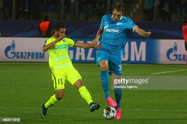 Artyom Dzuba of Zenit and Kenneth Saief of KAA Gent in action during the UEFA Champions League Group H football match between Zenit StPetersburg and...