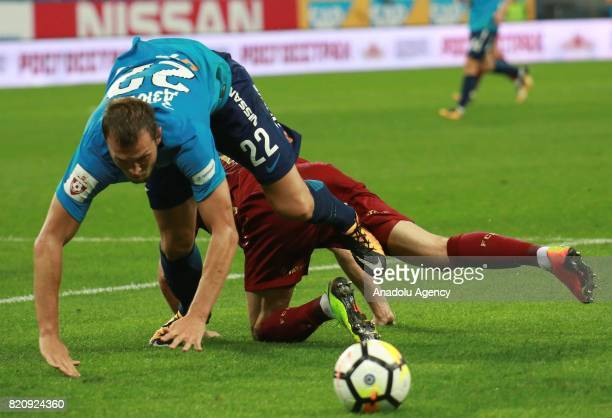 Artyom Dzuba of Zenit in action against his opponent of Rubin Kazan during the Russian Football Premier League match between Zenit St Petersburg vs...