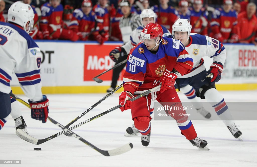 Artyom Manukyan #10 of Russia skates the puck up ice against the United States during the third period of play in the Quarterfinal IIHF World Junior Championship game at the KeyBank Center on January 2, 2018 in Buffalo, New York.