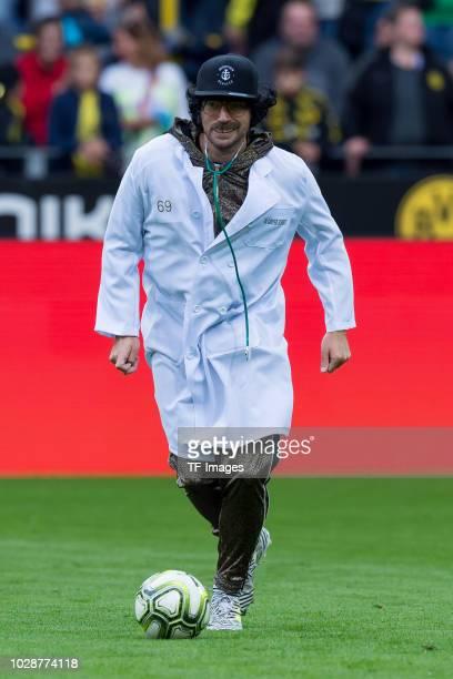 Artz Guenther Schmitz of Roman and Friends controls the ball during the Roman Weidenfeller Farewell Match between BVB Allstars and Roman and Friends...