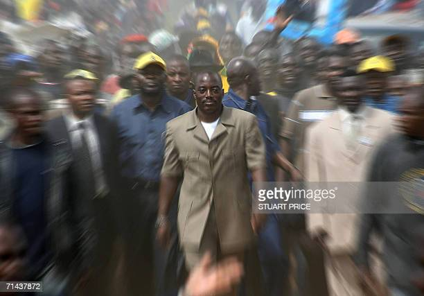 Transitional president and presidential candidate for the People's Party for Progress and Democracy Joseph Kabila is surrounded by supporters during...