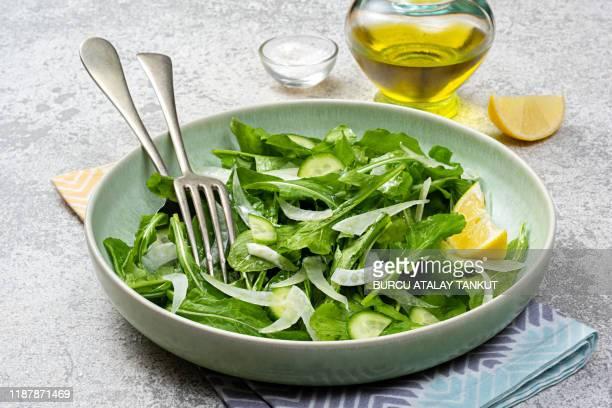 arugula fennel salad with lemon - arugula stock pictures, royalty-free photos & images