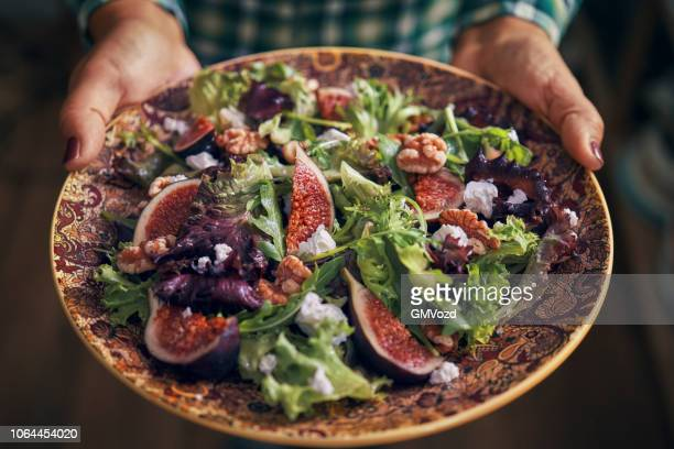 arugula fig salad with walnuts and feta cheese - greek food stock pictures, royalty-free photos & images