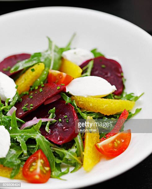 Arugula Salad with beets, tomatoes, oranges and mozzarella cheese