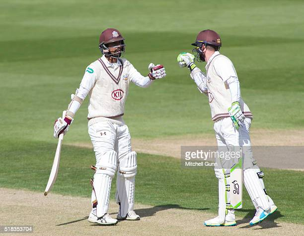 Arun Harinath celebrates scoring a half century with Steven Davies of Surrey during the match between Surrey and Loughborough University at the Kia...
