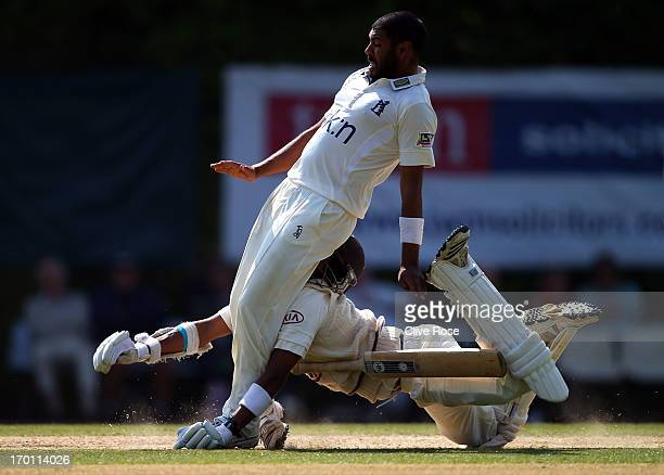 Arun Harinath of Surrey collides head first with Jeetan Patel of Warwickshire during day three of the LV County Championship Division One match...
