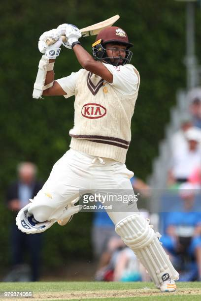 Ollie Pope of Surrey pulls the ball for four runs during day 1 of the Specsavers County Championship Division One match between Surrey and Somerset...