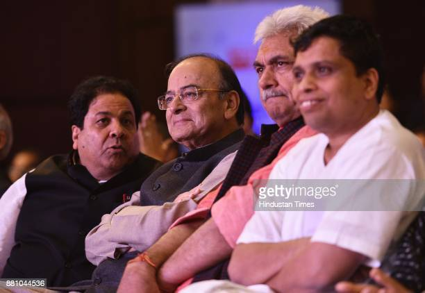 Arun Jaitley Finance Minister along with Rajeev Shukla a former vicepresident of the BCCI and Patanjali's CEO Acharya Balkrishna during an award...