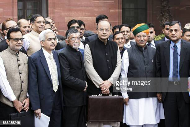 Arun Jaitley India's finance minister center and other members of the finance ministry stand for a photograph outside the North Block of the Central...
