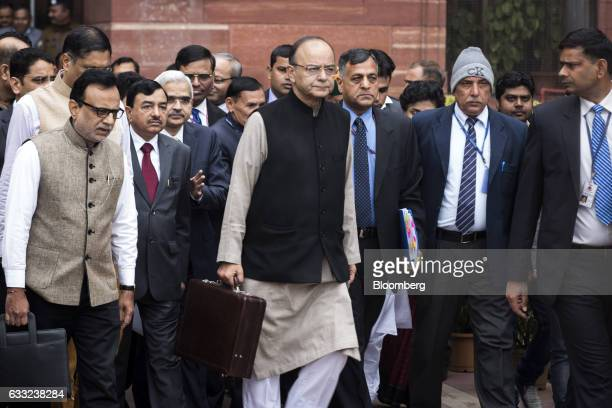 Arun Jaitley India's finance minister center and other members of the finance ministry leave the North Block of the Central Secretariat building...