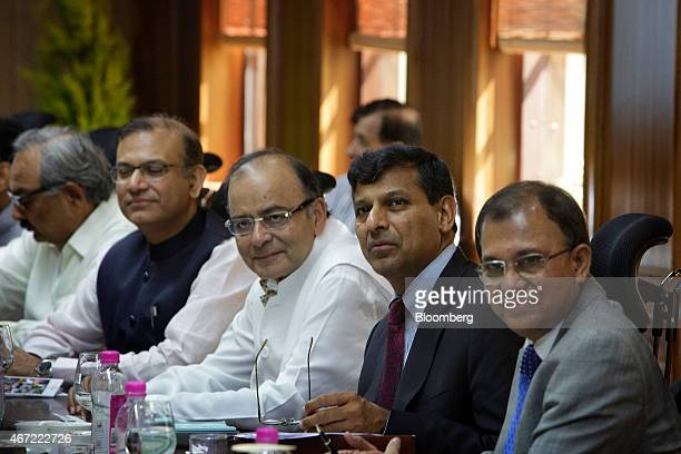 Arun Jaitley, India's finance minister, center, and Raghuram Rajan, governor of the Reserve Bank of India , second right, attend a meeting at the...