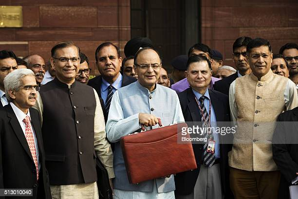 Arun Jaitley India's finance minister center Jayant Sinha junior finance minister second left and other members of the finance ministry stand for a...