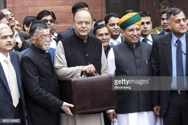 Arun Jaitley India's finance minister center left and other members of the finance ministry stand for a photograph outside the North Block of the...