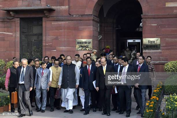 Arun Jaitley India's finance minister center left and other members of the finance ministry depart the North Block of the Central Secretariat...