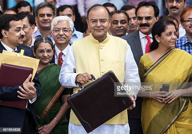 Arun Jaitley India's finance minister center Pompa Babbar financial commissioner of railways front row second left Arvind Mayaram finance secretary...