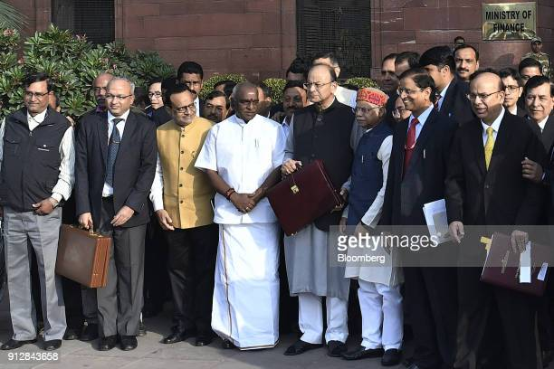 Arun Jaitley India's finance minister center right and other members of the finance ministry stand for a photograph outside the North Block of the...