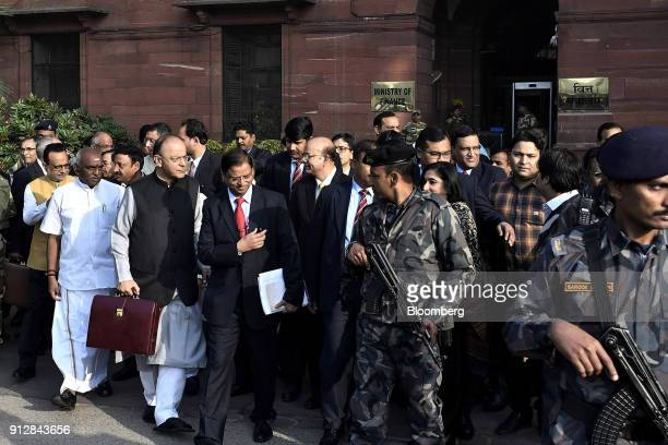 Arun Jaitley India's finance minister front second left and other members of the finance ministry depart the North Block of the Central Secretariat...