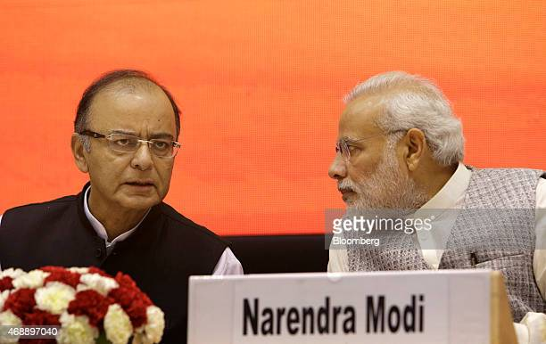 Arun Jaitley India's finance minister left speaks to Narendra Modi India's prime minister at the launch of the Micro Units Development and Refinance...