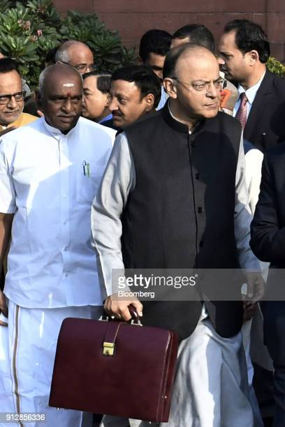 Arun Jaitley India's finance minister right and other members of the finance ministry depart the North Block of the Central Secretariat building to...