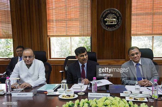 Arun Jaitley, India's finance minister, second left, and Raghuram Rajan, governor of the Reserve Bank of India , second right, attend a meeting at...