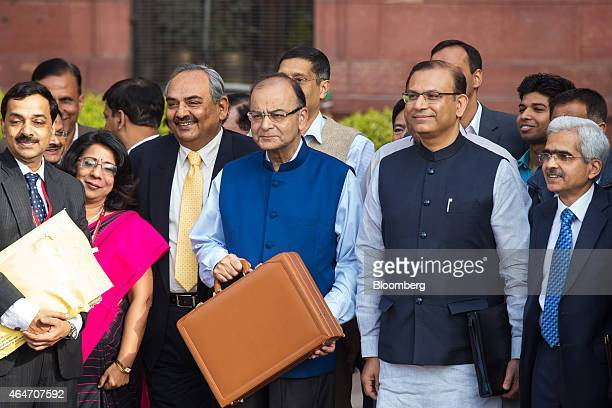 Arun Jaitley India's finance minister third right Rajiv Mehrishi finance secretary third left Jayant Sinha junior finance minister second right and...